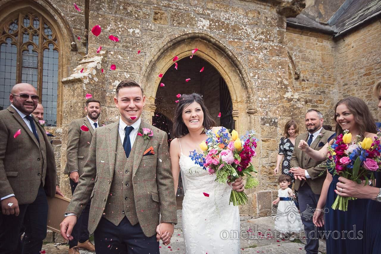 Confetti Countryside Wedding Photos outside of church