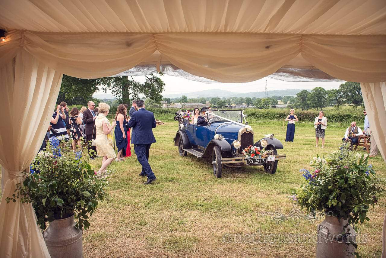 Countryside Wedding Photos as the newlyweds arrive for marquee reception