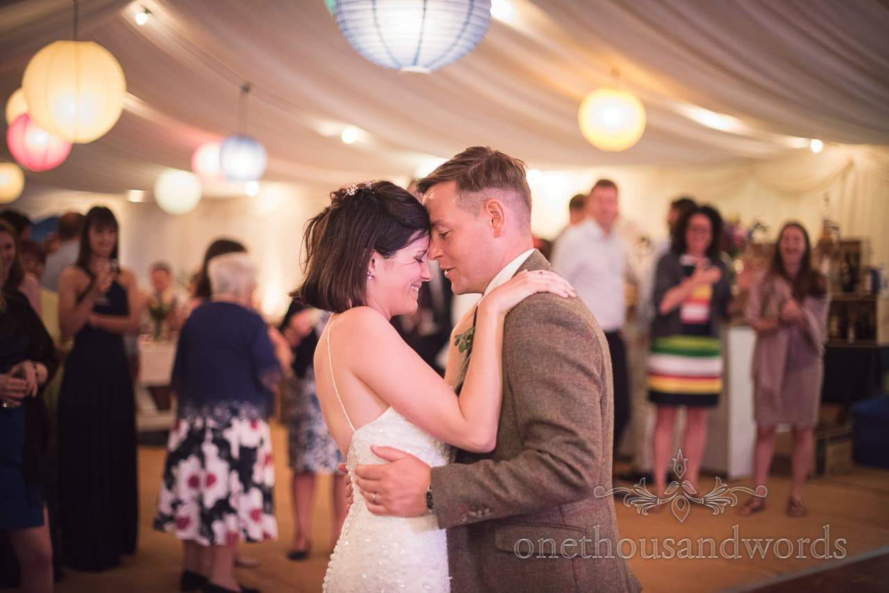 Countryside Wedding Photos of bride and groom dancing in wedding marquee