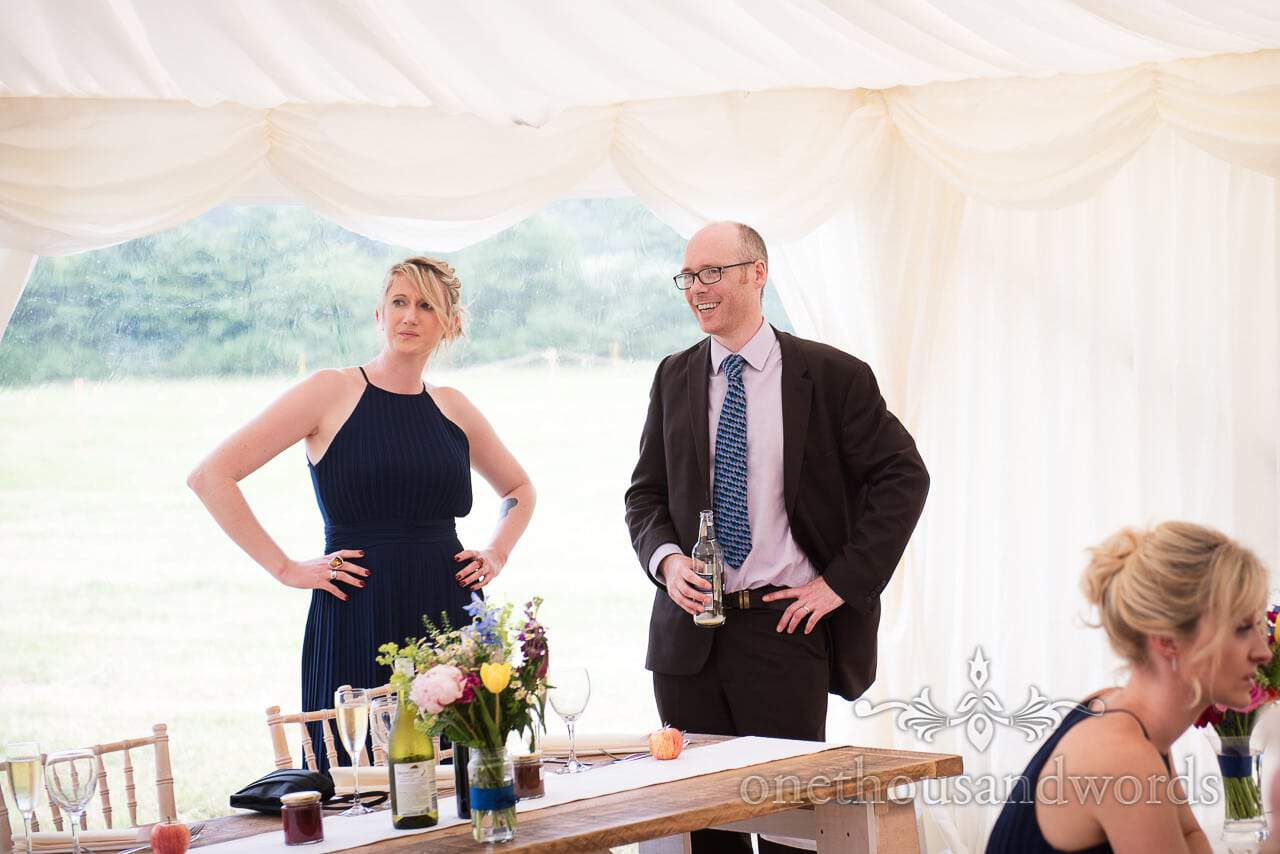 Countryside Wedding Photos of bridesmaid and guest during marquee reception