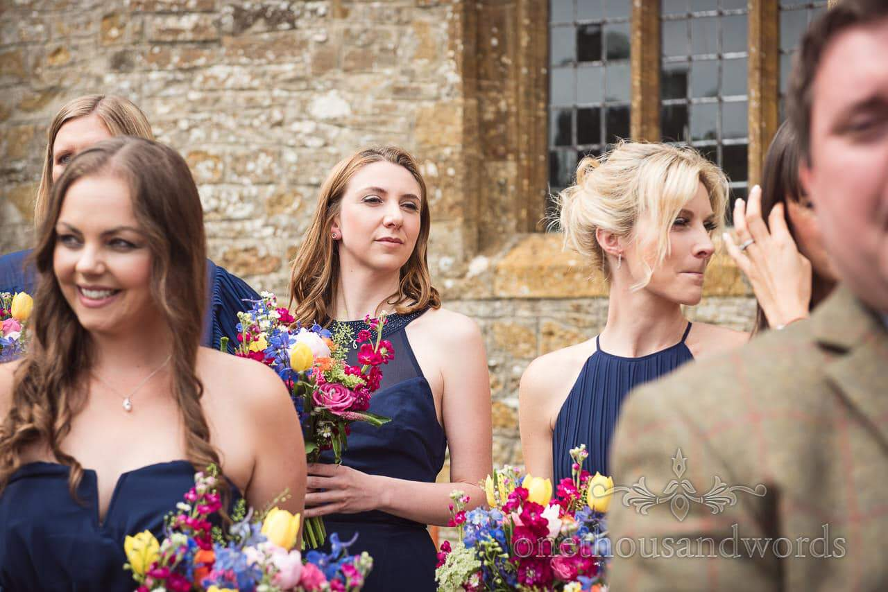 Countryside Wedding Photos of bridesmaids in blue outside the church