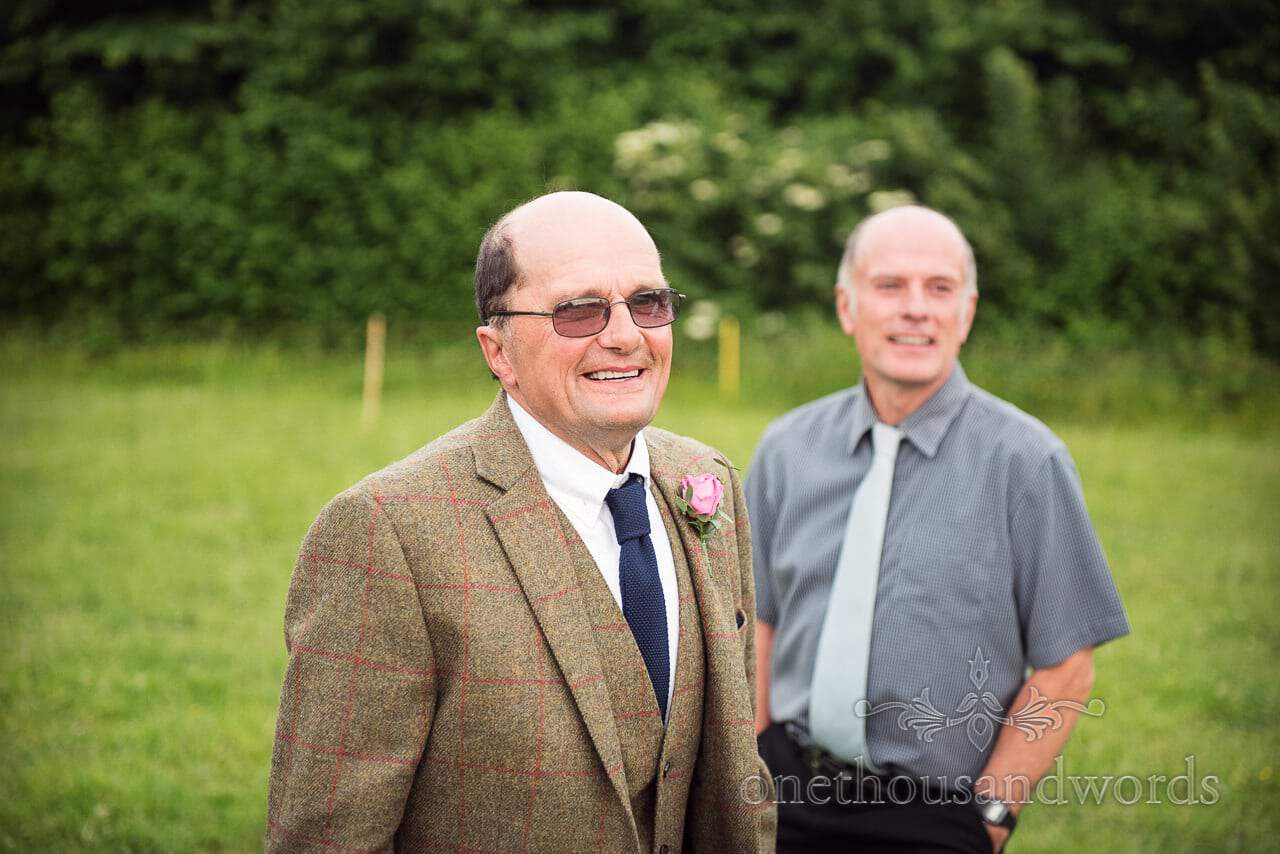 Countryside Wedding Photos of father of the bride during farm reception