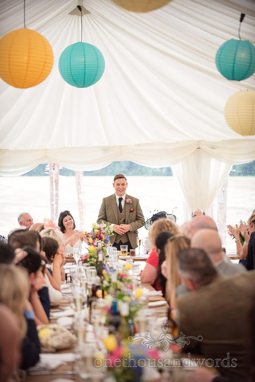 Countryside Wedding Photos of groom delivering speech at marquee reception