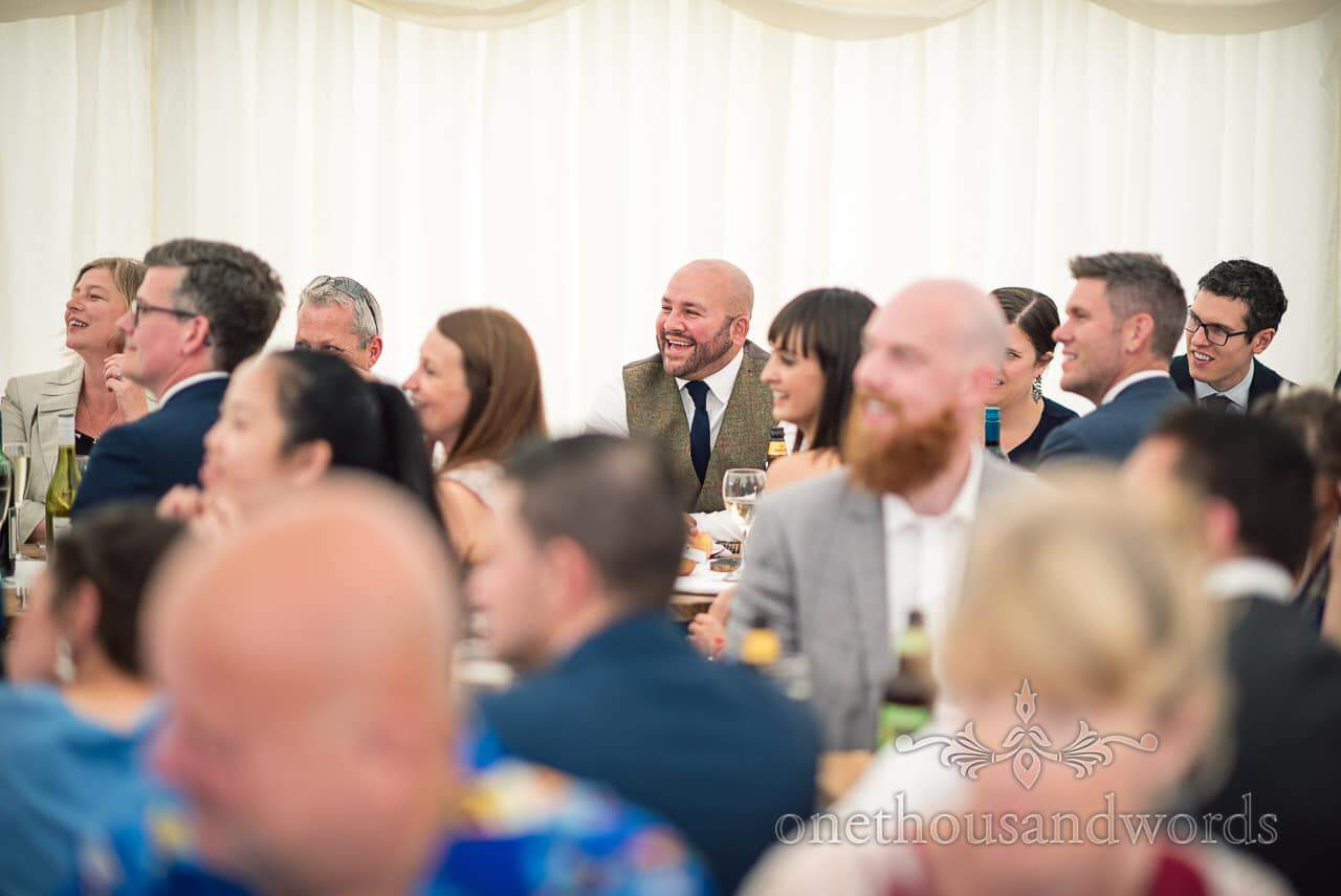 Countryside Wedding Photos of groomsman reaction to speeches