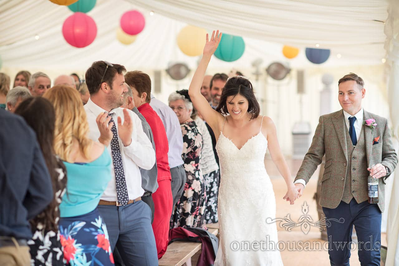 Countryside Wedding Photos of the new Mr and Mrs entering the marquee