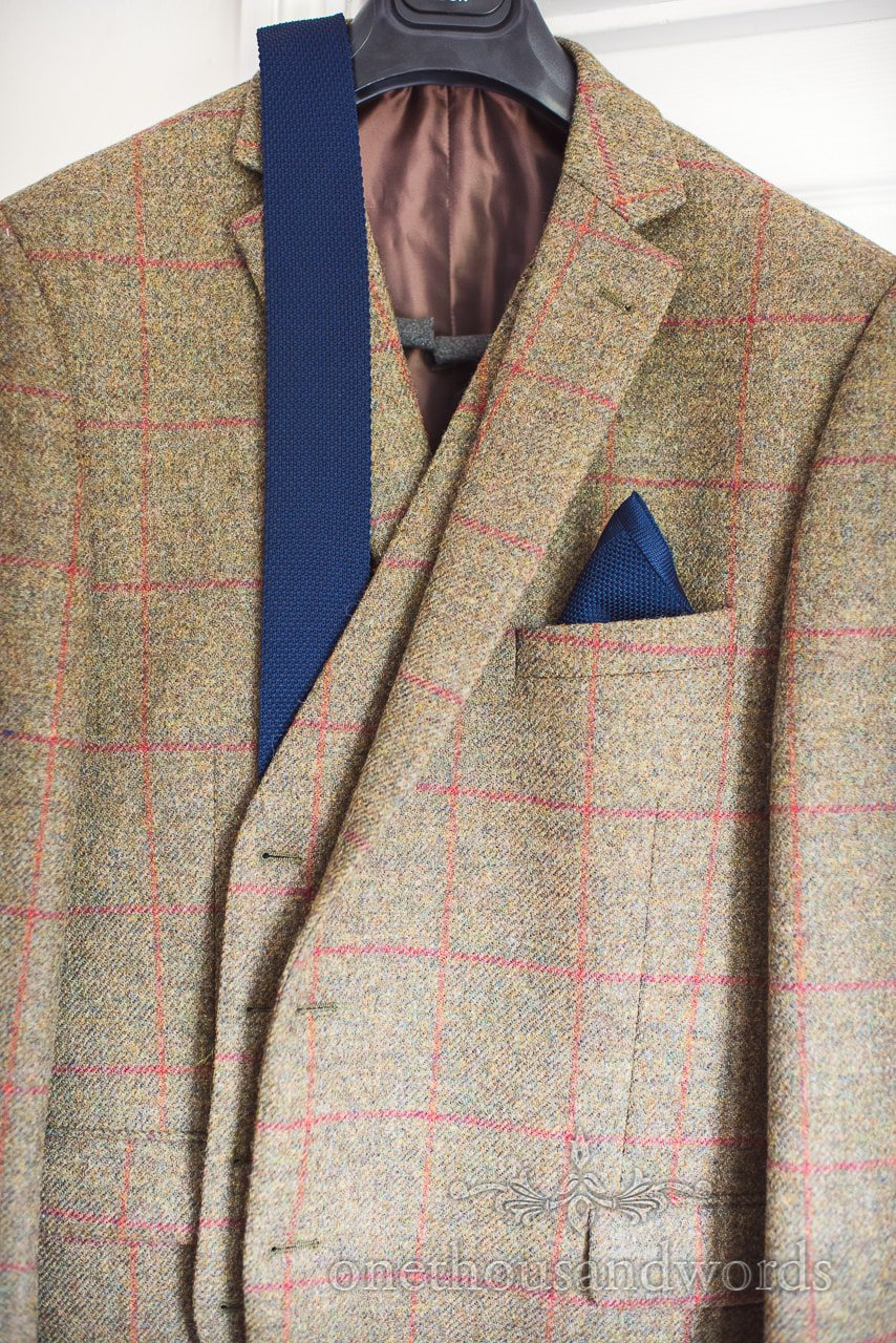 Countryside Wedding Photos of tweed jacket waistcoat with navy blue tie and pocket square