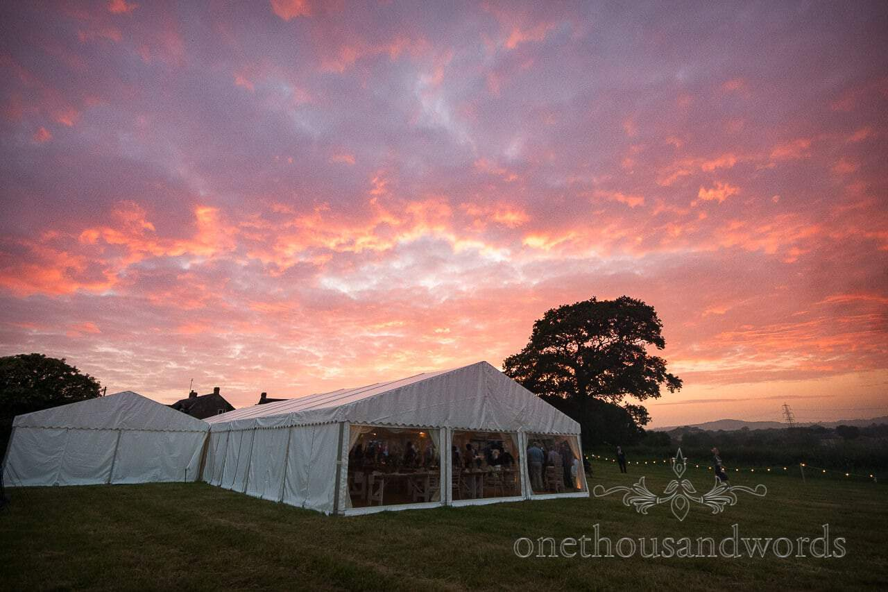 Countryside Wedding Photos of wedding marquee with spectacular sunset
