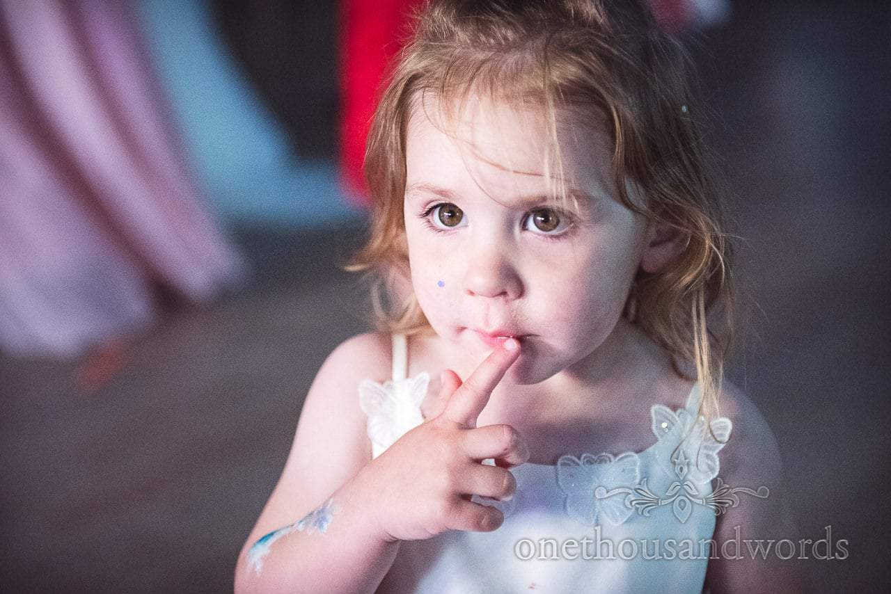 Cute flower girl during wedding reception from Swanage Wedding Photos