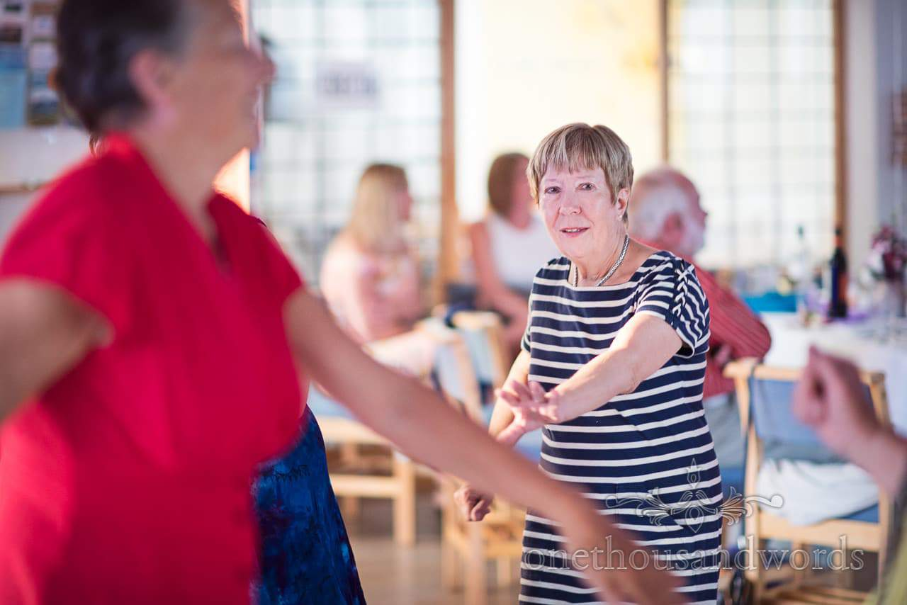 Dancing guests at evening reception at All Saints church in Swanage