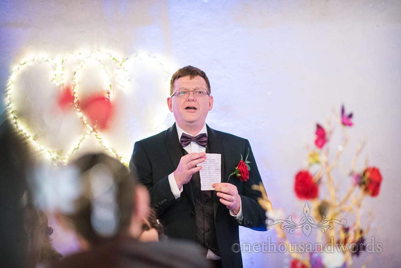 Father of the bride with red rose button hole and tiny wedding speech