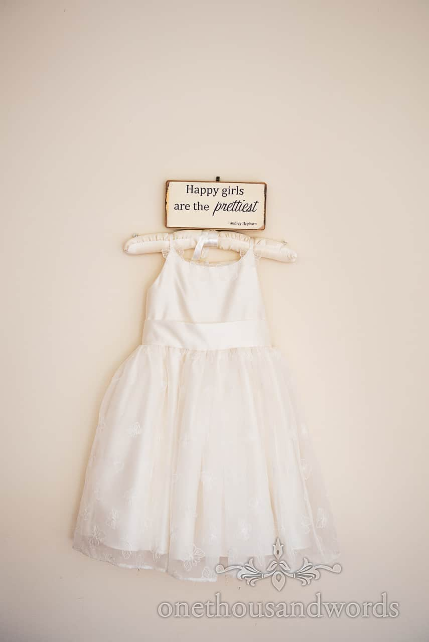 Flower girl dress with Hepburn quote from morning of Swanage wedding photos