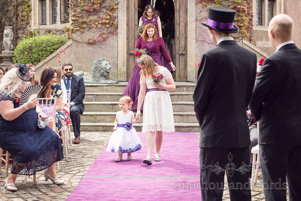 Flower girls lead wedding procession at Chocolate Themed Wedding Photographs
