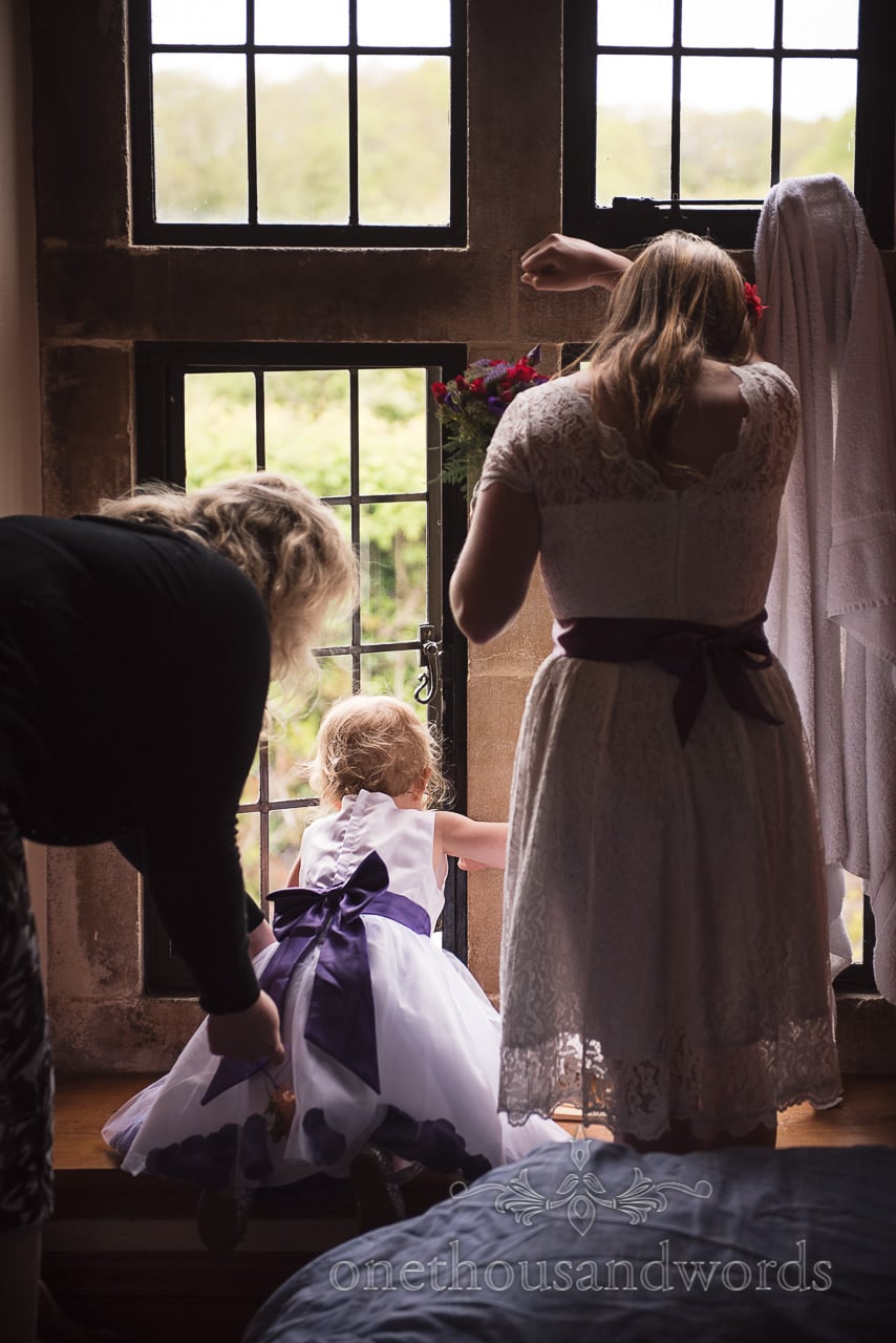 Flower girls look out of the castle window from Chocolate Themed Wedding Photographs