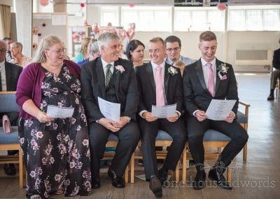 Groom and best man share joke with parents from Swanage wedding photos