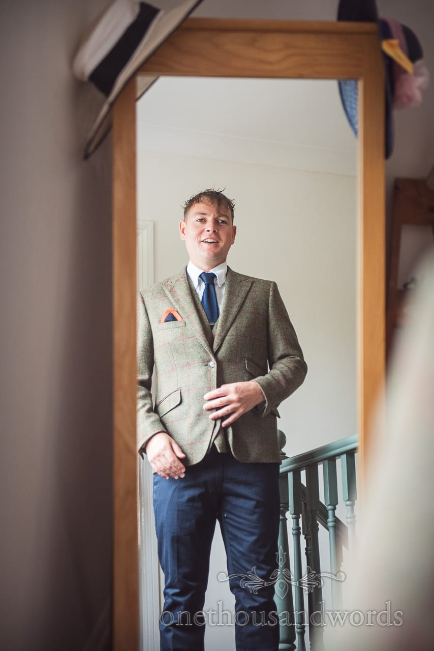 Groom in mirror readies himself for Countryside Wedding Photos