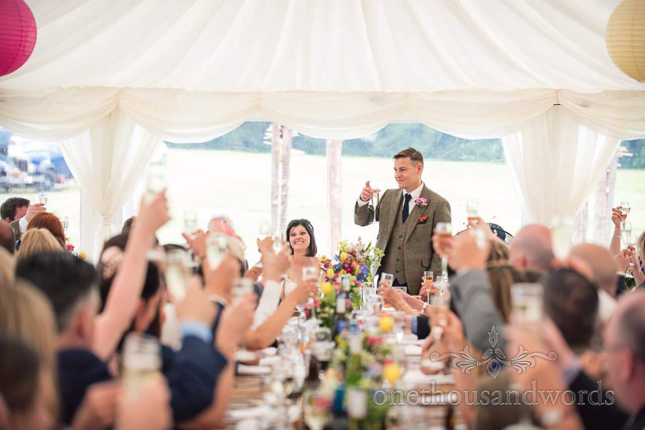 Groom raised his glass to toast during Countryside Wedding reception