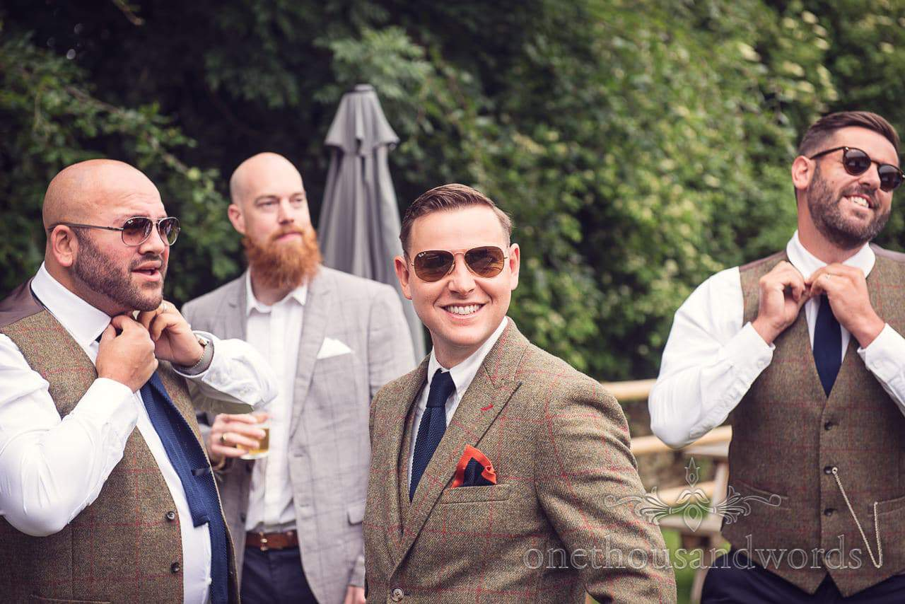 Groomsmen and groom in sunglasses in pub garden from Countryside Wedding Photos