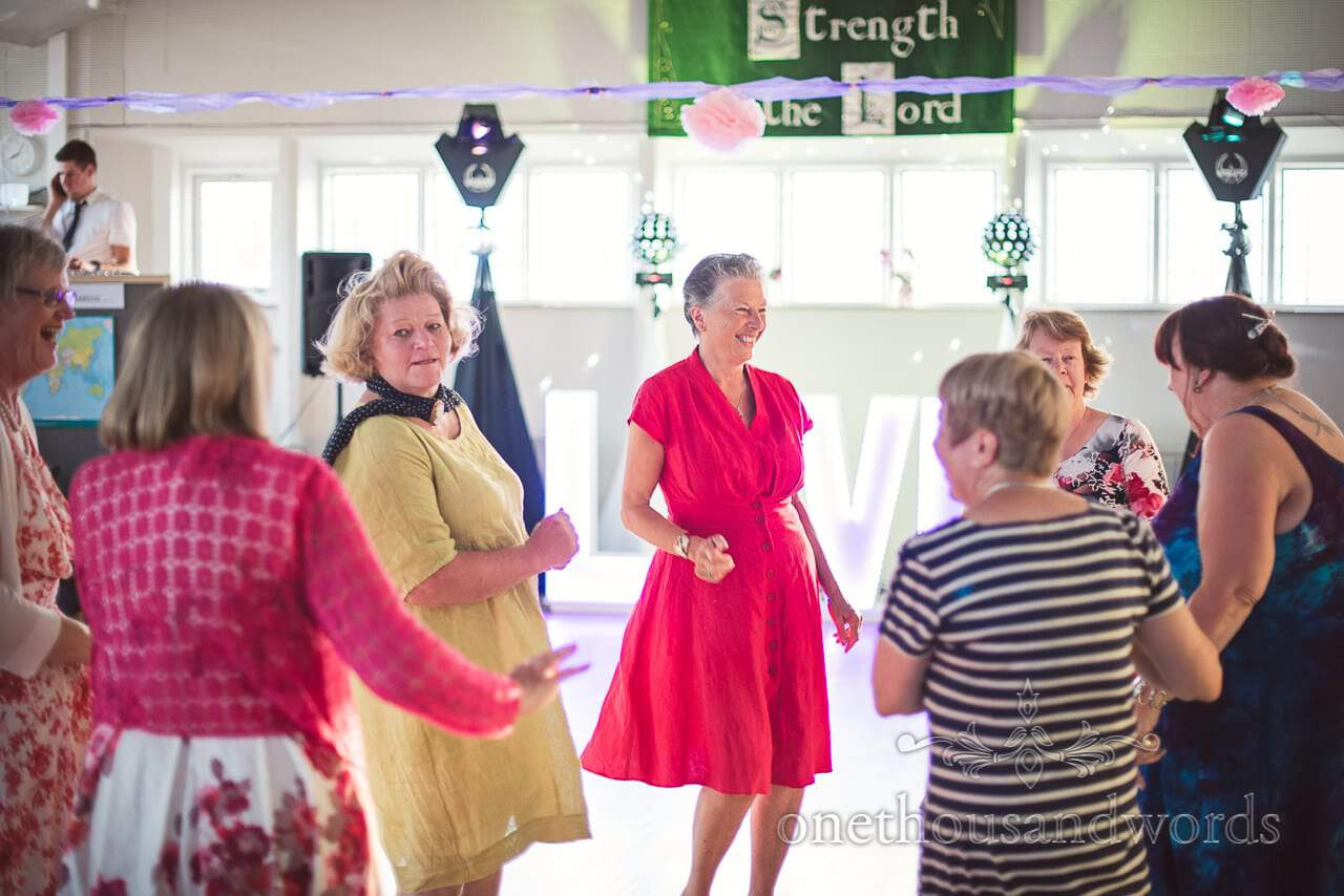 Groups of dancing guests from Swanage church wedding
