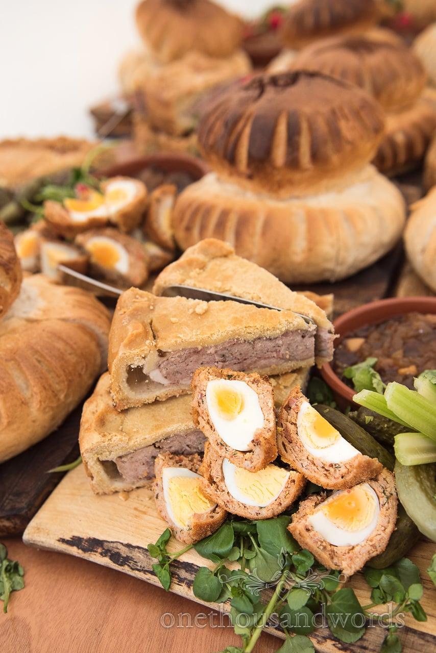 Hand made scotch eggs and pork pie from Dorset wedding buffet food photograph