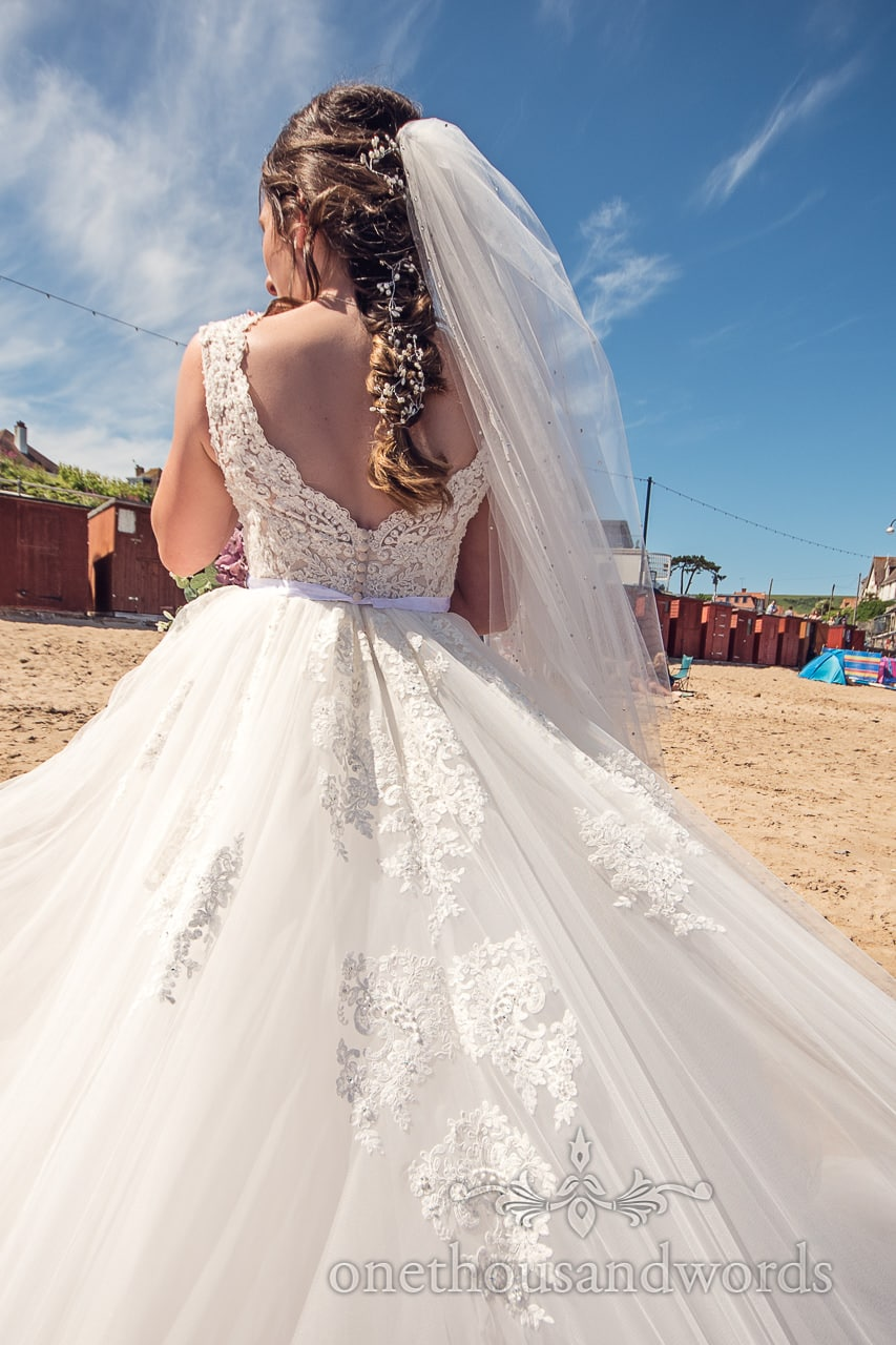Lace detailed back of wedding dress from morning of Swanage wedding photos