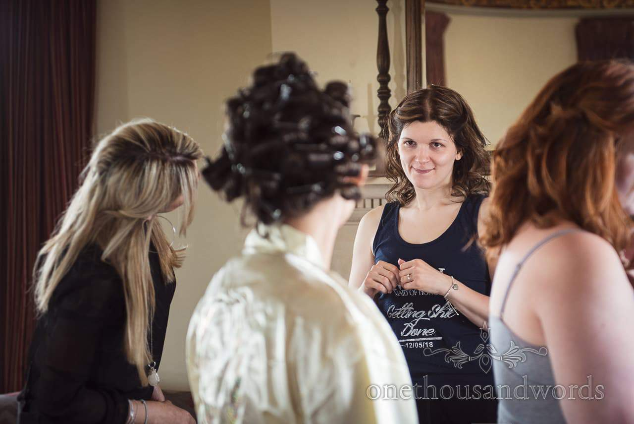 Maid of Honour looks at the bride during preparations before Chocolate Themed Wedding Photographs
