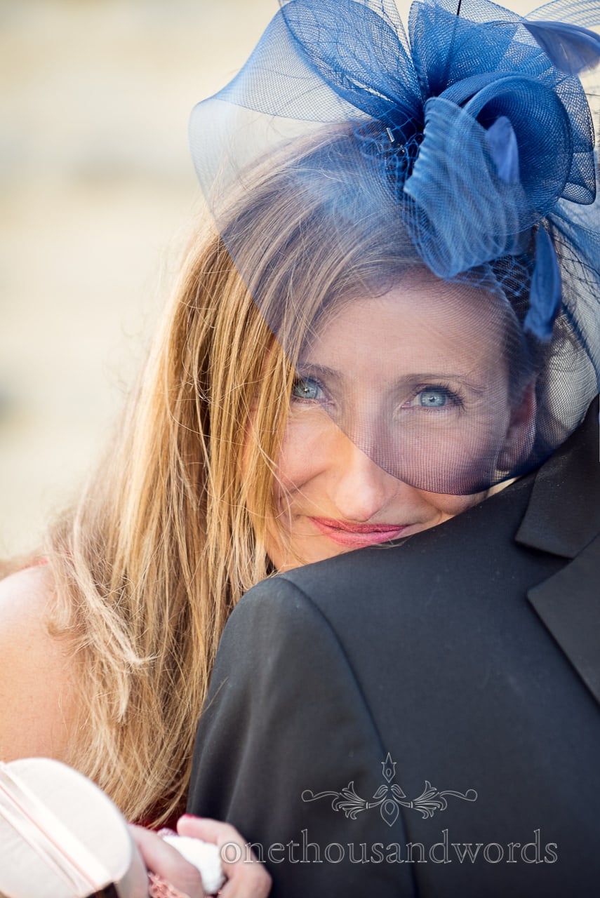 Mother of the bride in blue facinator from Swanage wedding photos