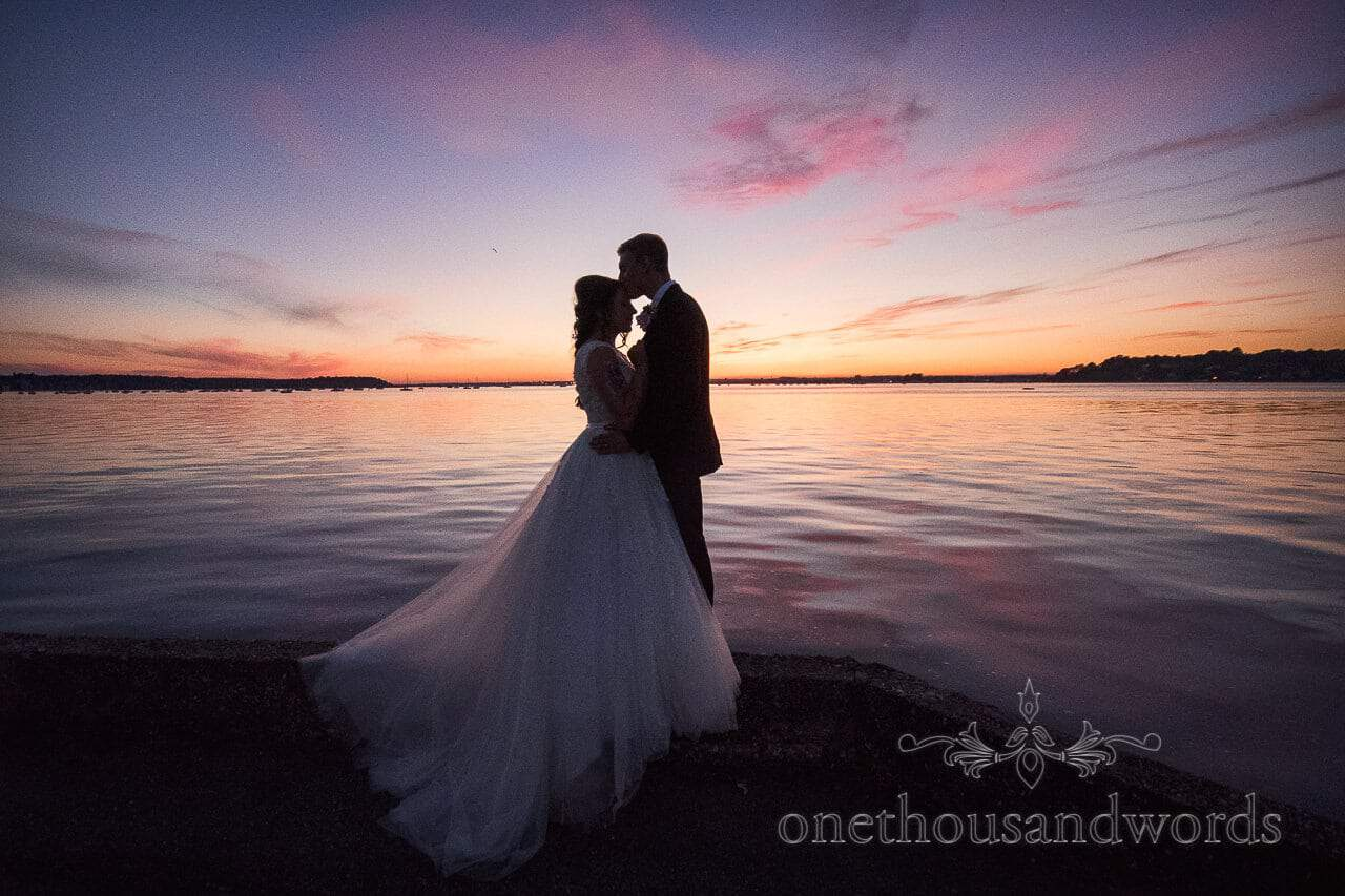 Newlyweds embrace at harbour sunset from Swanage Wedding Photos