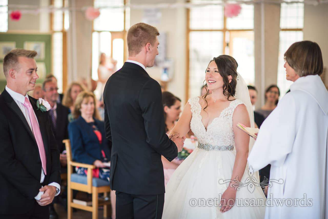 Smiling bride during ceremony at All Saints church in Swanage
