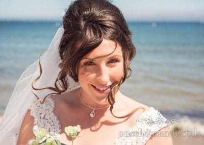 Smiling bride on beach from morning of Swanage Wedding Photos