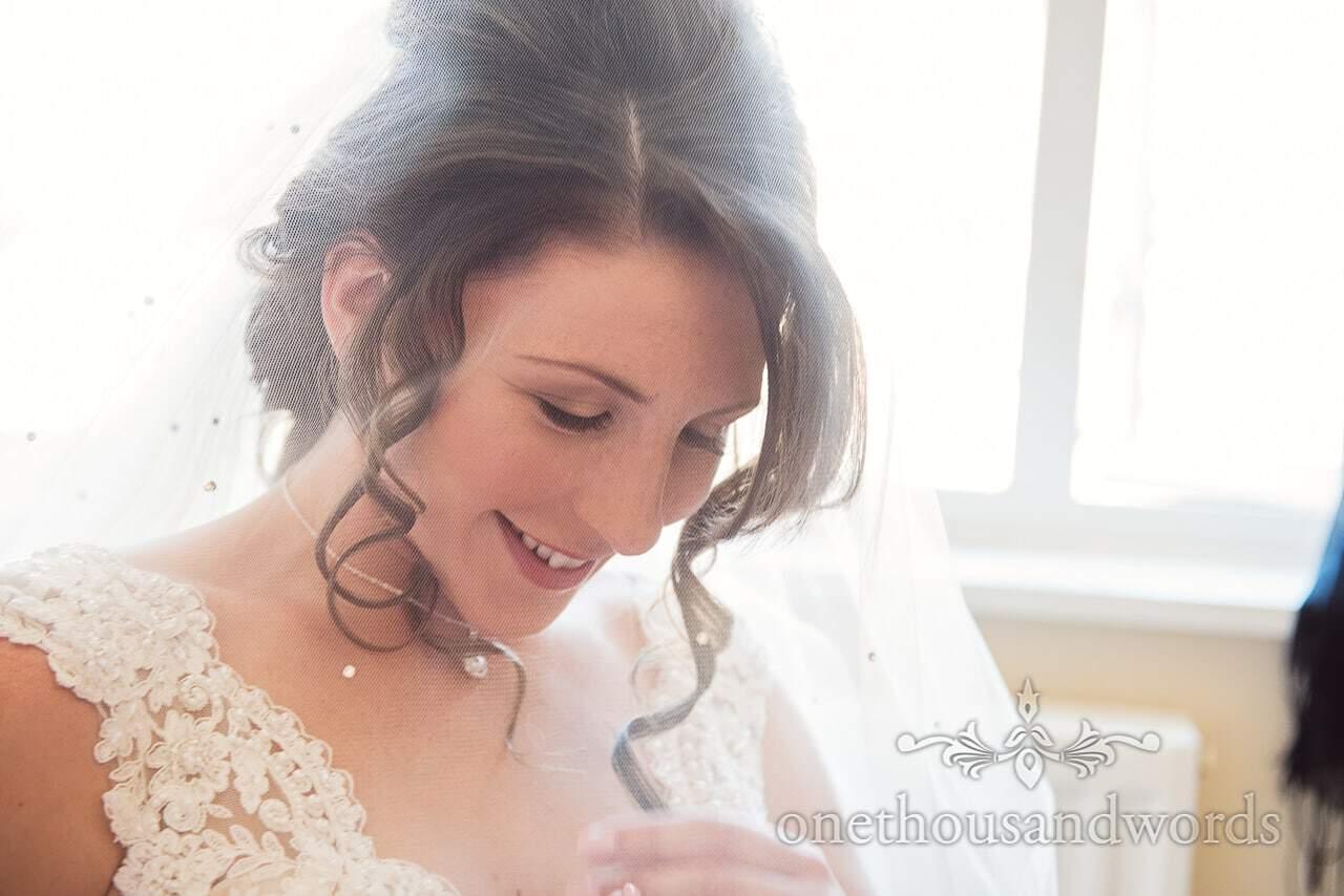 Smiling bride through veil on morning of Swanage Wedding Photos