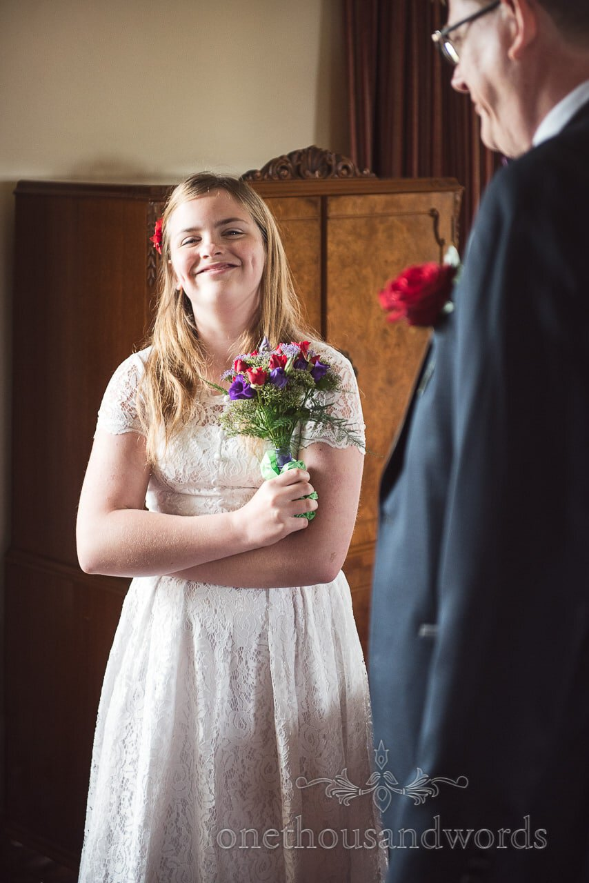Smiling flower girl with floral bouquet from Chocolate Themed Wedding Photographs