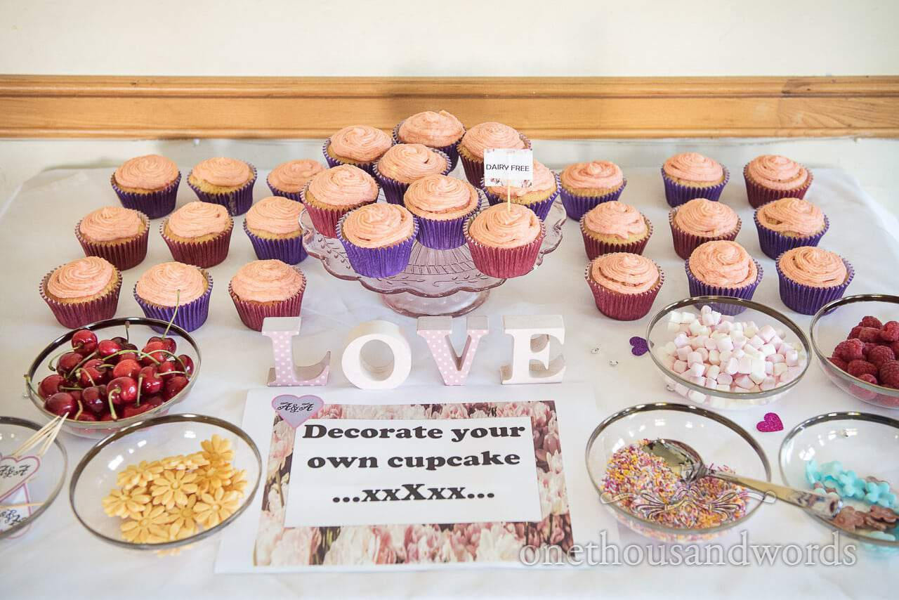 Table of decorate your own cupcakes from Swanage wedding photos