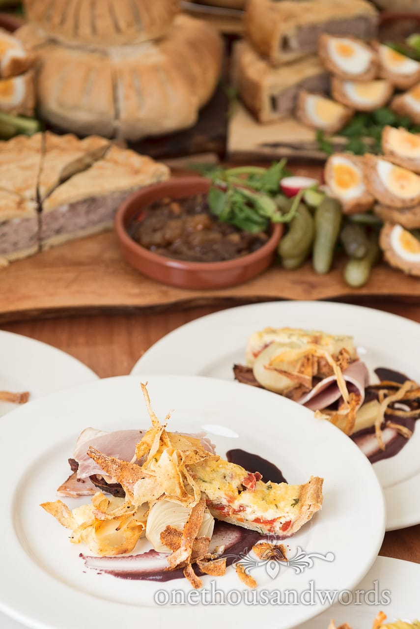 tomato quiche with parsnip shavings pickled onion and ham buffet wedding food