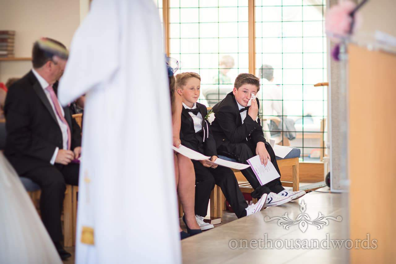 Usher dries his eyes during ceremony from Swanage wedding photos