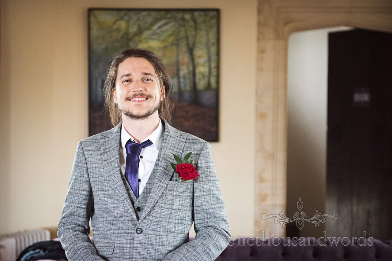 Usher in grey checked suit and red rose buttonhole from Chocolate Themed Wedding Photographs