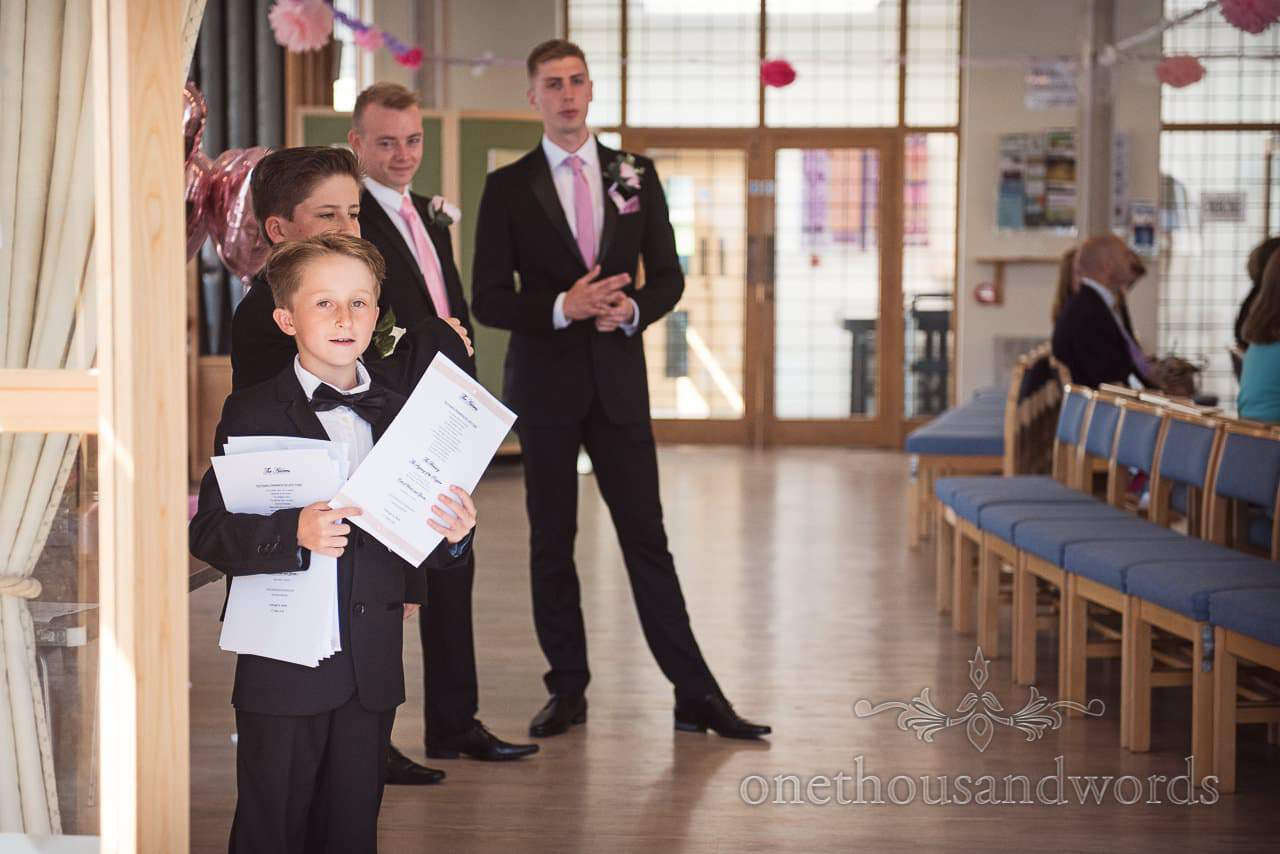 Ushers with orders of survive wait to greet guests from Swanage wedding photos