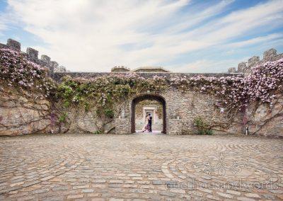 Walton Castle wedding photograph Castle walls and stone floor with bride and groom