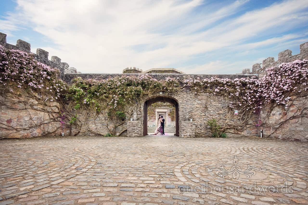 Walton Castle wedding photograph Castle walls and stone floor with bride and groom