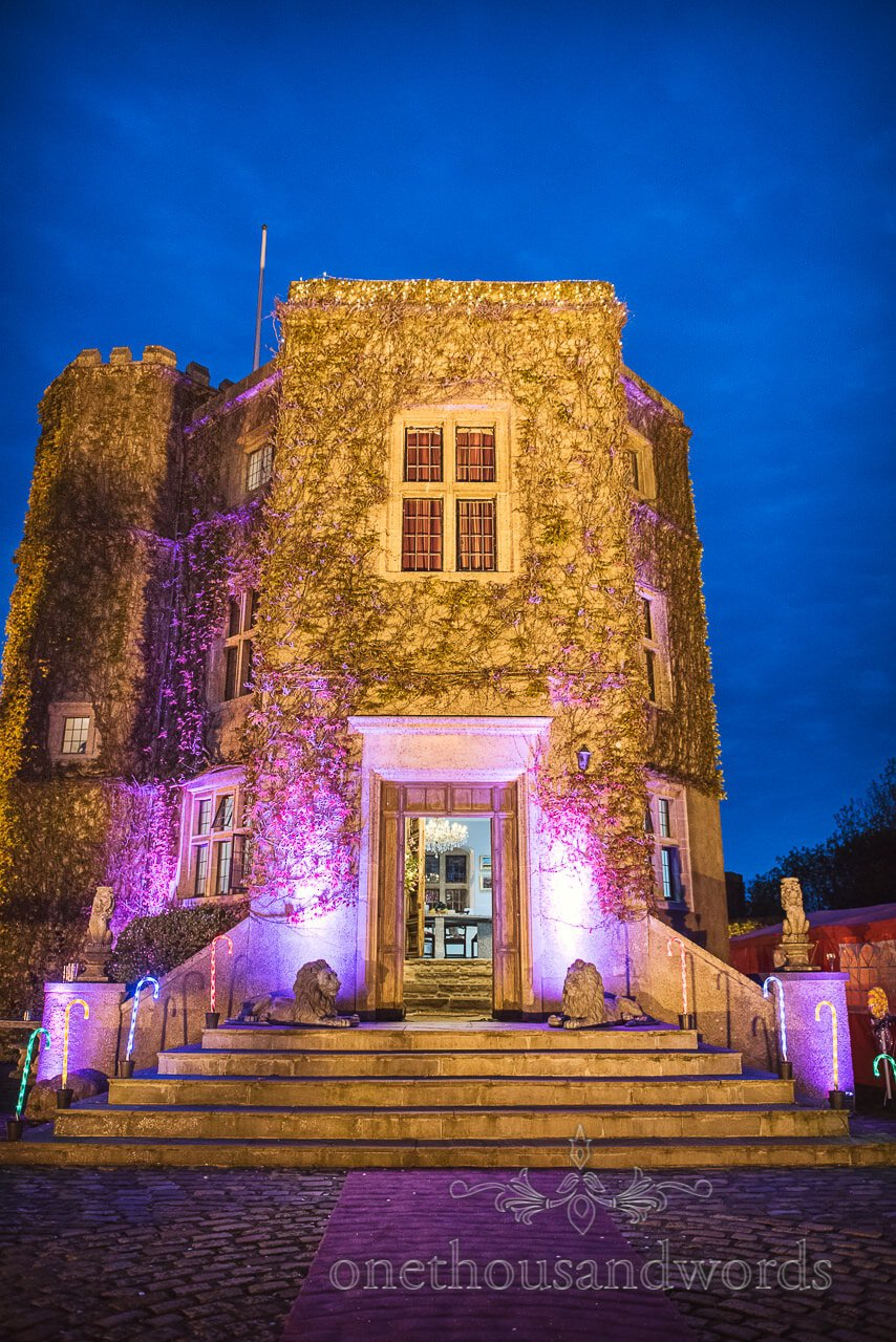 Walton Castle wedding venue in Bristol up lit at night by one thousand words