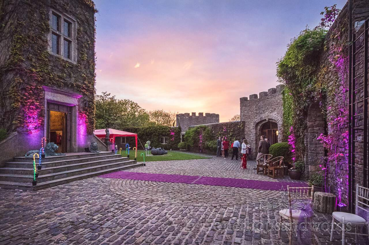 Walton Castle wedding venue with sunset and coloured lighting
