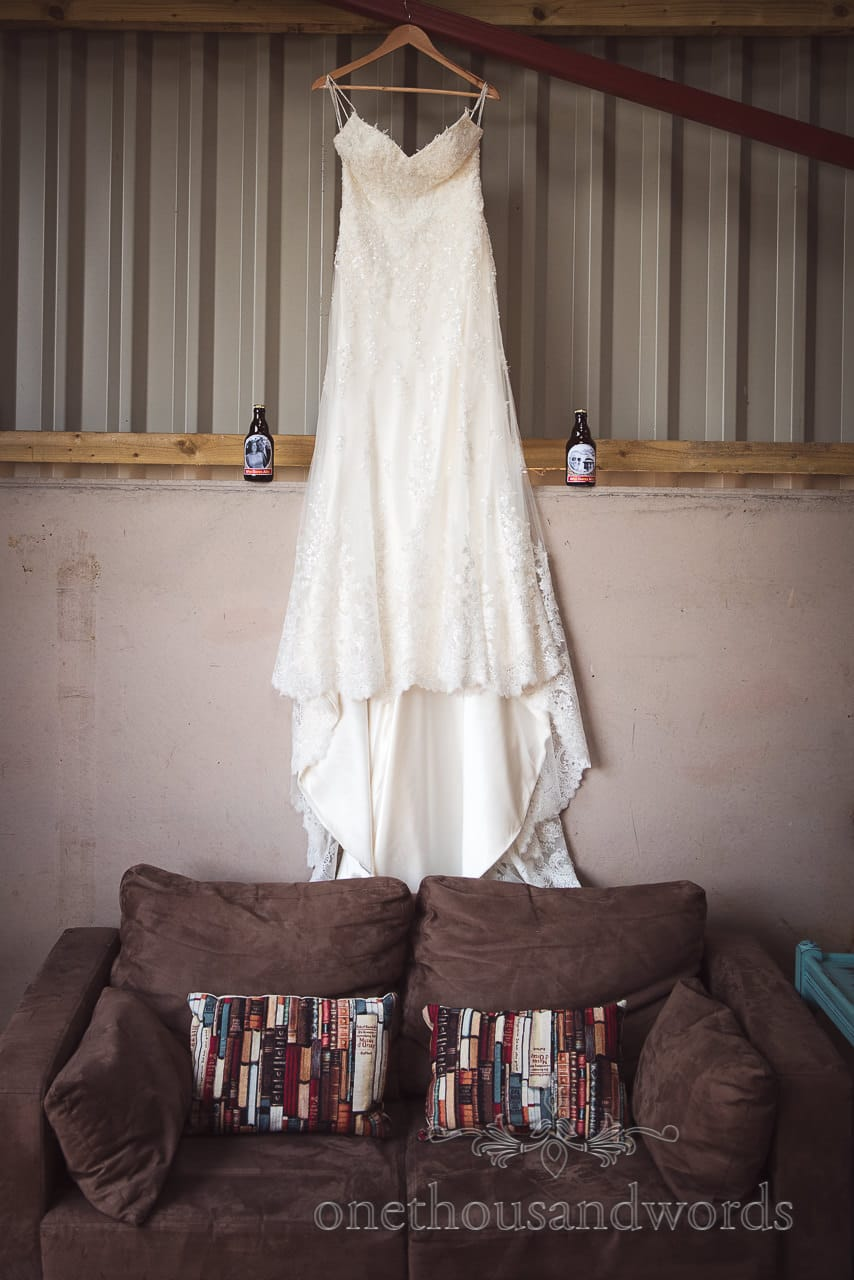 Wedding dress hangs in the barn from Countryside Wedding Photos