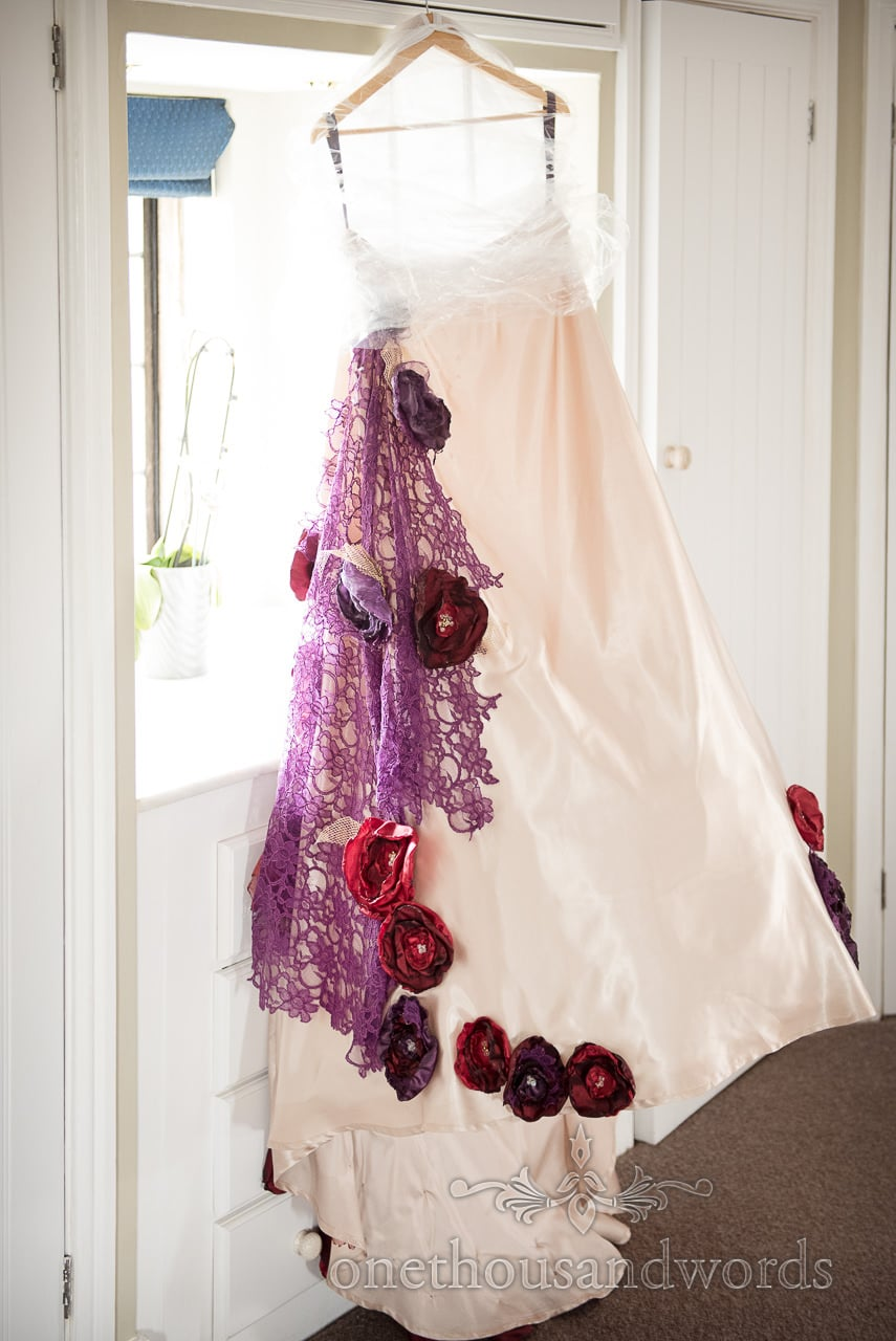Wedding dress hangs in the window from Chocolate Themed Wedding Photographs