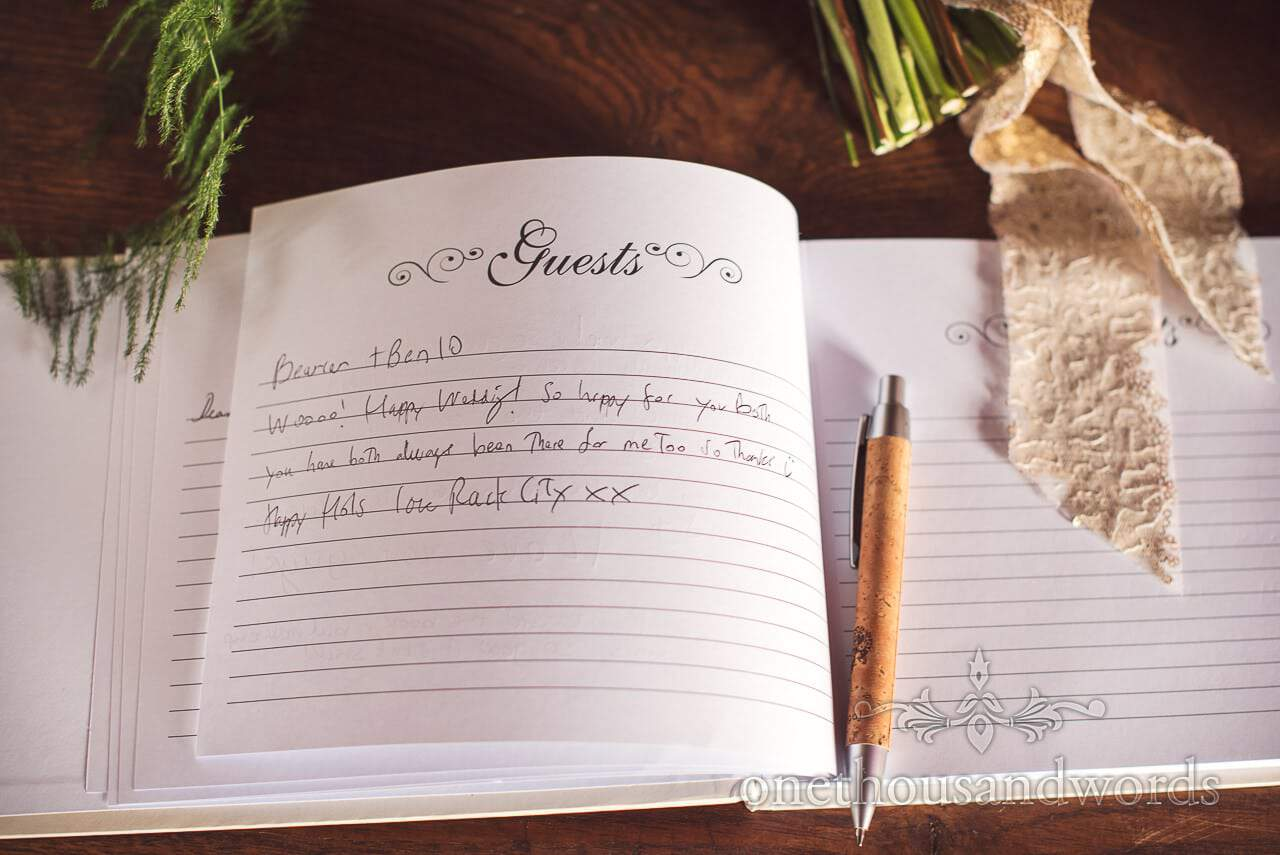 Wedding guest book for messages from wedding guests with pen