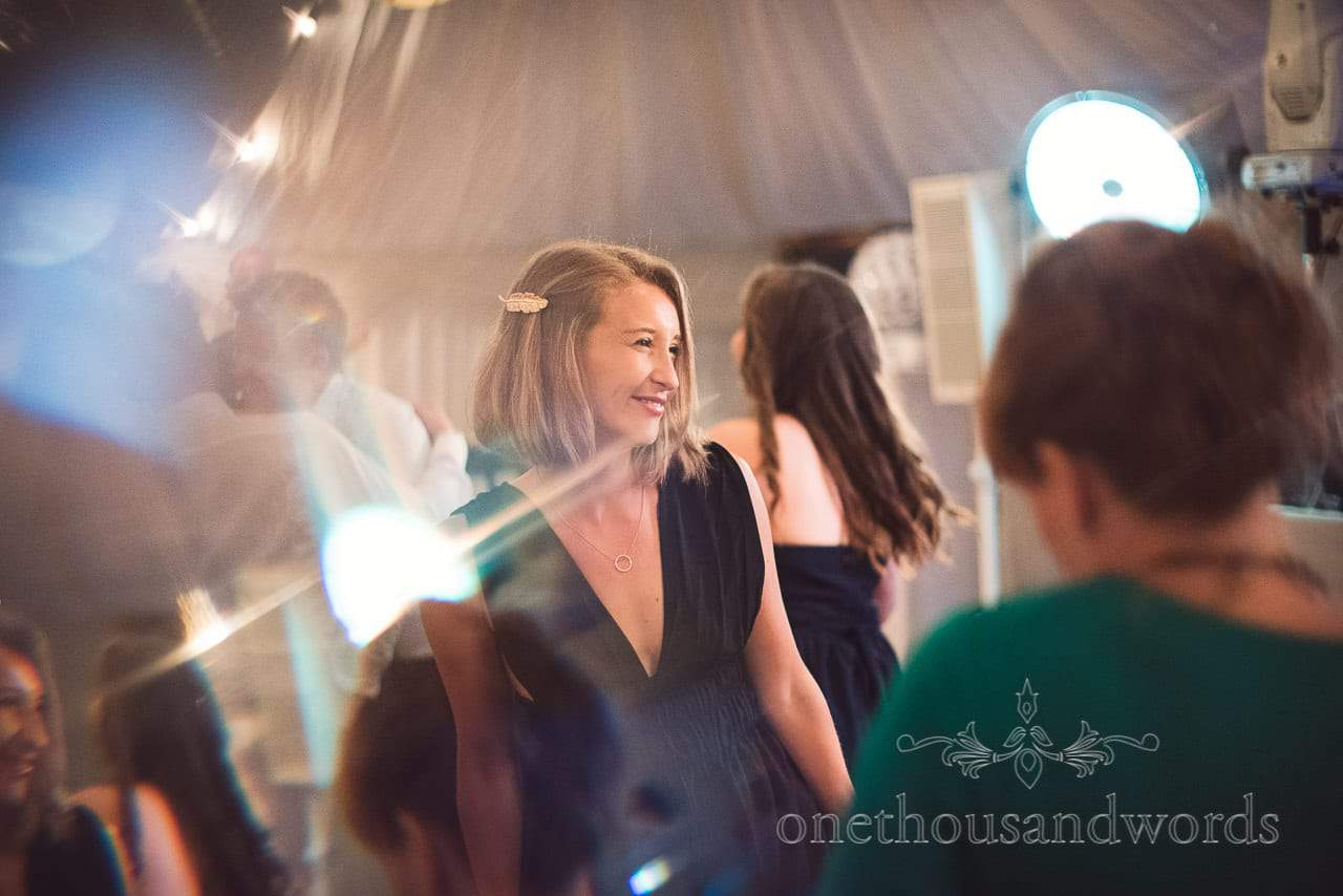 Wedding guests evening disco dancing in Countryside Wedding marquee