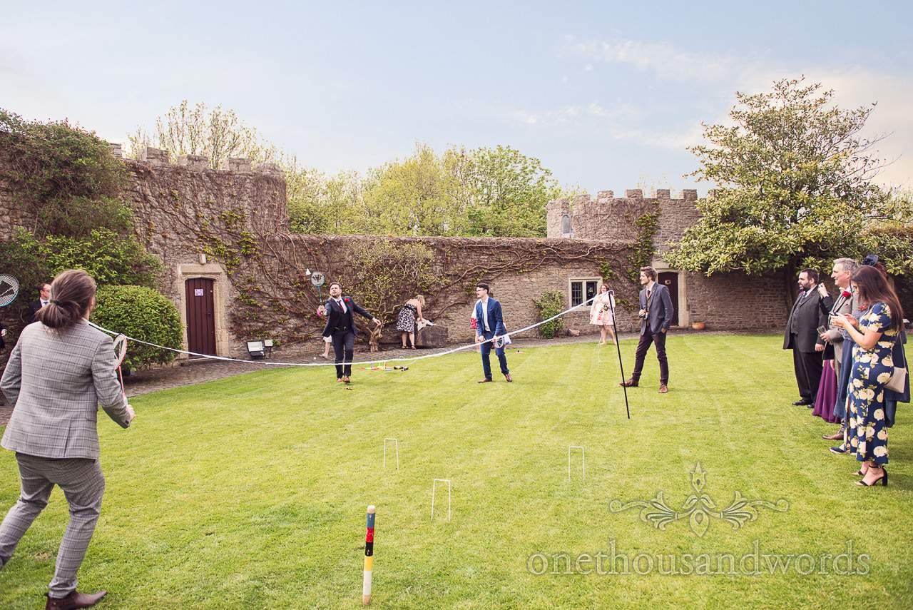 Wedding guests play badminton at Walton Castle wedding in Bristol