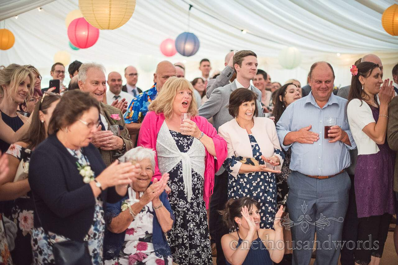 Wedding guests react to choreographed first dance in wedding marquee