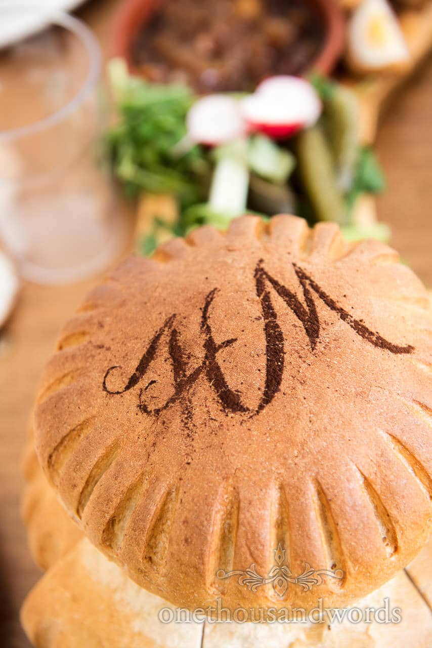 Wedding hand made bread with monogram topping wedding food photograph