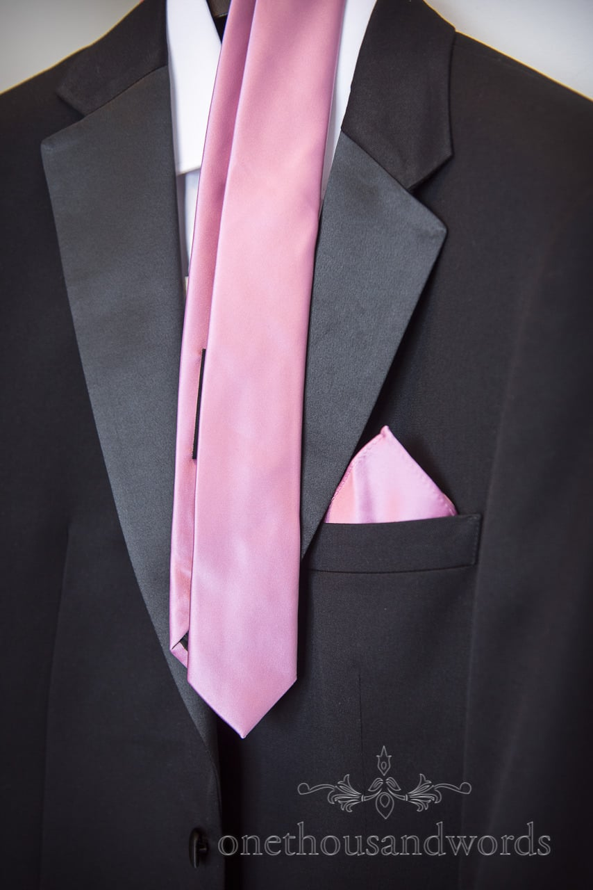 Wedding suit with pink tie and matching pocket square from Swanage wedding photos