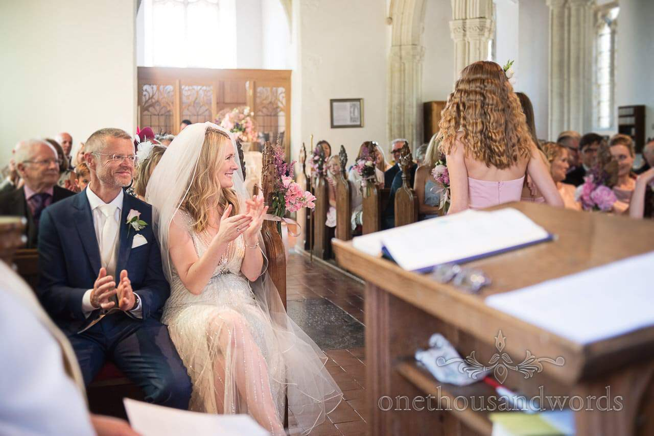 Applause for reading during church ceremony from Countryside Wedding