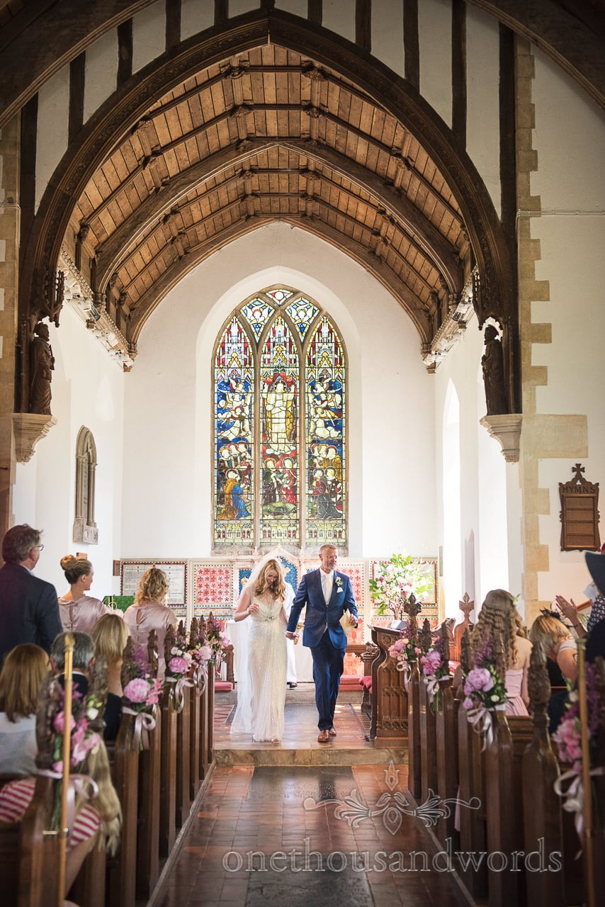 Applause for the newlyweds in church from countryside wedding